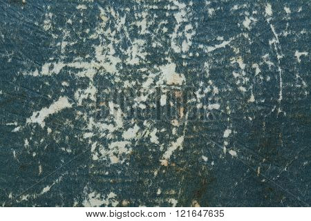 Badly damaged dark blue cardboard texture.