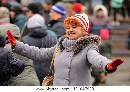 Orel, Russia - March 13, 2016: Maslenitsa, Pancake festival. Woman dancing in the street
