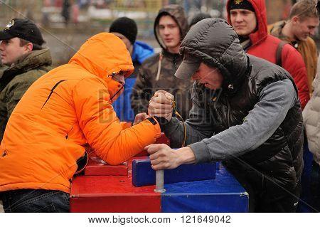 Orel, Russia - March 13, 2016: Maslenitsa, Pancake Festival. Men Armwrestling
