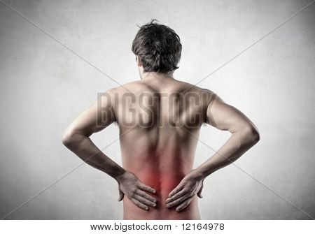 Rear view of a man with backache