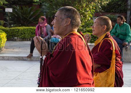 Two monks praying at temple in Kathmandu, Nepal