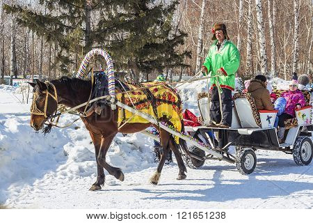 The Horse Harnessed By The Cart Is Lucky People On The Russian Holiday Maslenitsa
