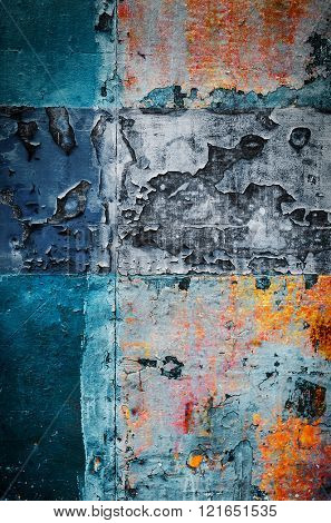 Old colorful rusty metallic surface with peeling paint and scratches