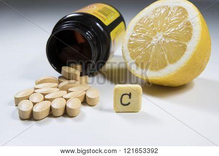Vitamin C  Lemon And Bottle On White