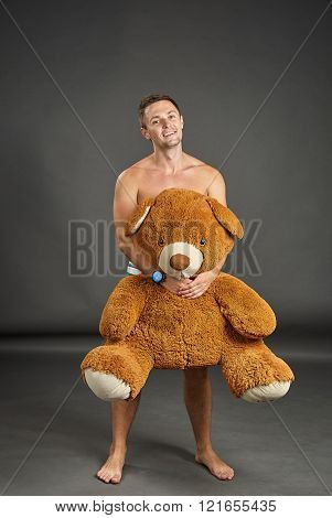 Portrait Of A Sexy Young Man With Big Plush Bear