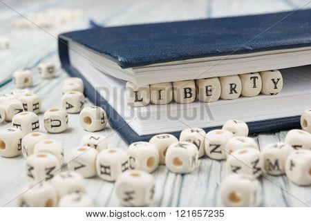 The word Liberty written wood block. Wooden ABC