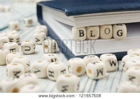 Blog word written on wood block. Wooden ABC