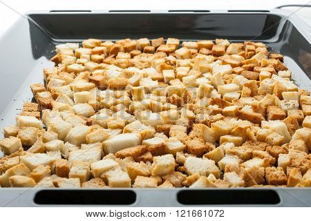 Small croutons on a baking tray horizontal