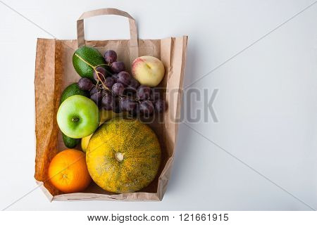 Fruit mix inside a paper bag background