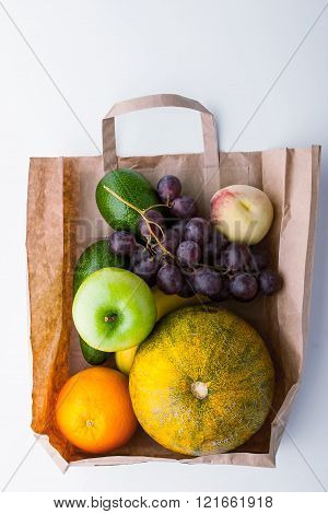Different fruit inside a paper bag background