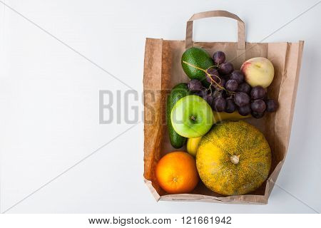 Assorted fruit inside a paper bag background