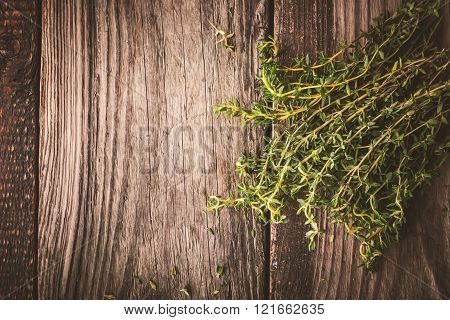 Bundle of thyme on the wooden board top view