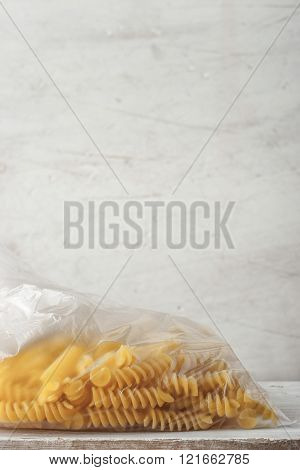 Pasta on the cellophane package background vertical