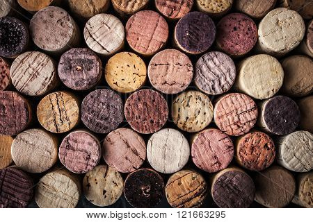 Wine corks red black purple background close-up