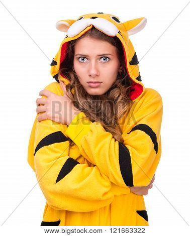 scared young woman dressed as a tiger