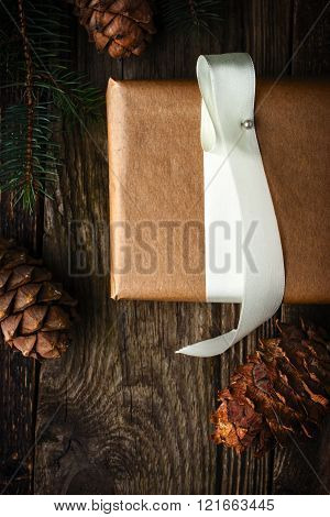 Homemade gift with fir tree and cone vertical . Christmas theme