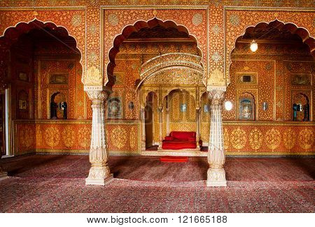 BIKANER, INDIA - MAR 4: Maharaja's resting room with arches in gold patterns inside 16th century Junagarh Fort on March 4, 2015. The 5.28 hectares large Fort precinct is studded with palaces temples