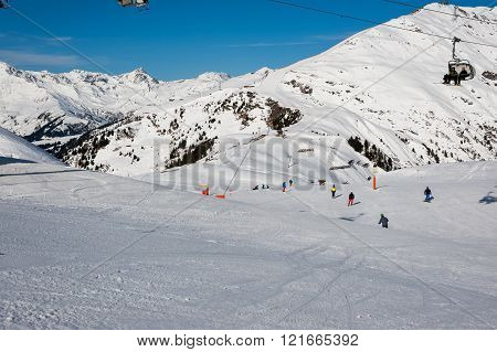 MAYRHOFEN, AUSTRIA :  MARCH 22, 2016:View of  skiers at Mayrhofen Ski resort area with ski lifts, pistes and skiers. Zillertal Alps, Tirol.