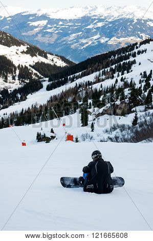 MAYRHOFEN, AUSTRIA :  MARCH 22, 2016:View of  skier resting at Mayrhofen Ski resort area with ski lifts, pistes and skiers. Zillertal Alps, Tirol.