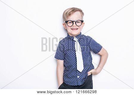 Little adorable kid in tie and glasses. School. Preschool. Fashion. Studio portrait isolated