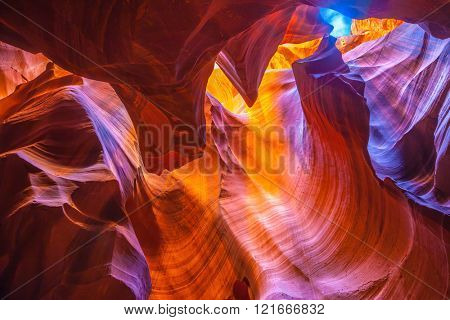 Arizona, USA. Bright orange and red colored clay covered delightful magical light. Upper Antelope Canyon in the Navajo reservation