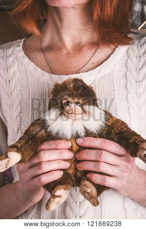 Present monkey toy in the woman hands relaxation,