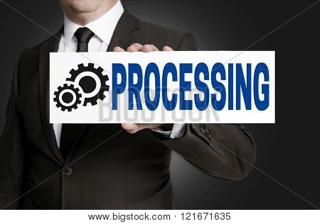 Processing Only Sign Is Held By Businessman