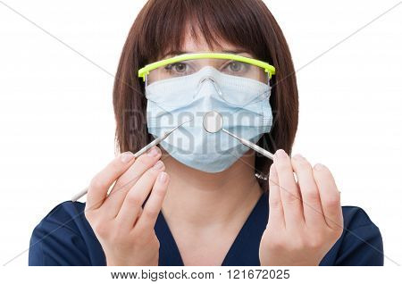 Dentist Woman Wearing Glasses And Holding Tools