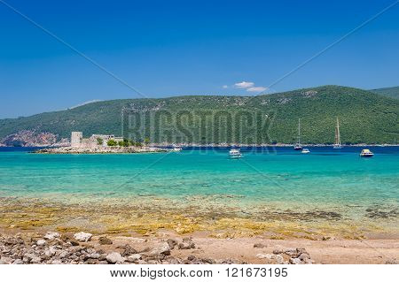 Beautiful turquoise bay, recreational boats and Mirista old fortress on the small island.