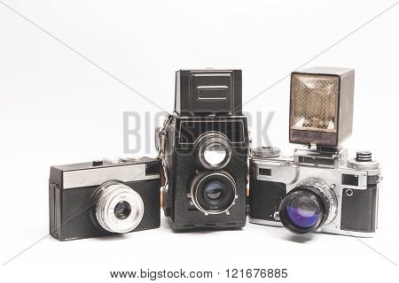 On a white background depicts different old cameras and other equipment