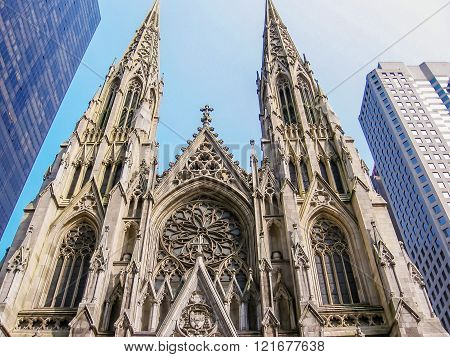 Manhattan, New York city, United States - circa April 2008:St. Patricks Cathedral a Neo Gothic style Roman Catholic cathedral and a prominent landmark of midtown Manhattan, New York City. Across the street from Rockefeller Center and facing the Atlas stat