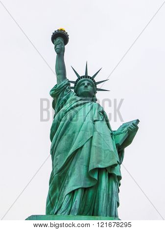 Statue of liberty on a cloudy white sky, New York, Bay of Manhattan, United States of America, view from front side