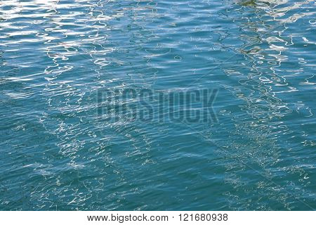 blue water surface with gentle ripples and reflections