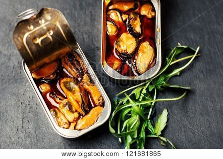 Mussels Over Black Background. Conserve / Canned / Tinned Sea Food.