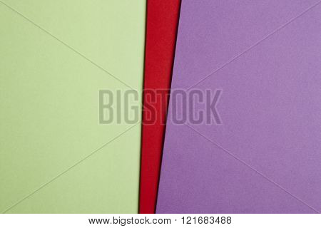 Colored Cardboards Background In Green Red Purple Tone. Copy Space