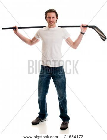 Man in jeans and white tee shirt with ice hockey equipment. Studio shot over white.