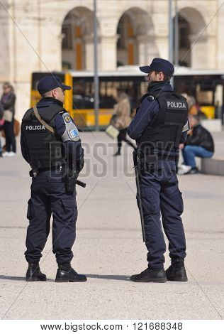 Police on duty at Praca dos Comercio Lisbon Portugal.