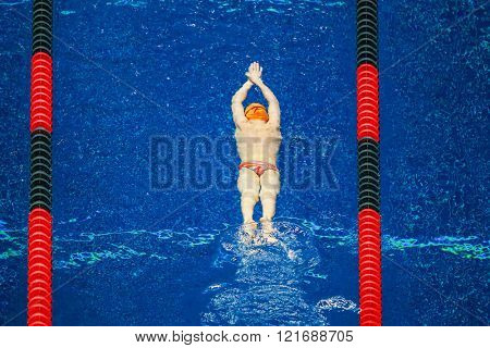 Young Swimmer warming up in the pool