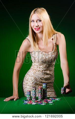 Young woman in casino gambling concept