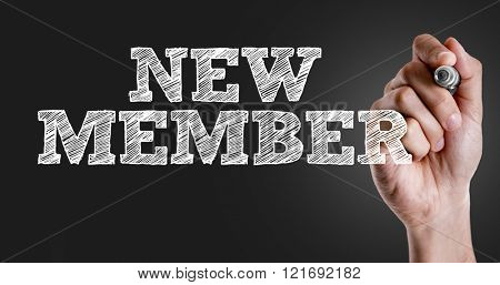 Hand writing the text: New Member