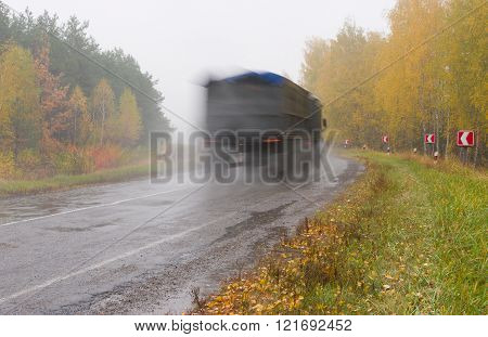 Autumnal landscape with highway rain and mist
