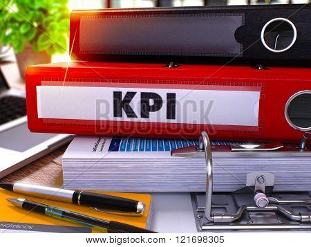 Red Ring Binder with Inscription KPI.