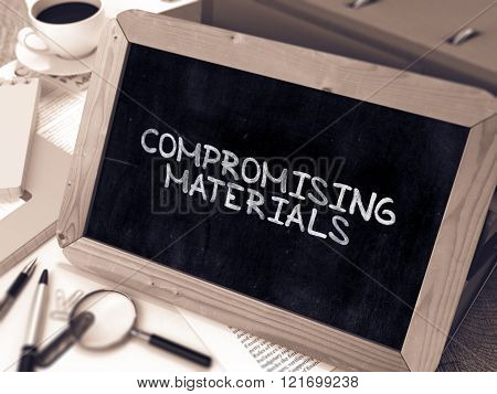 Compromising Materials Concept Hand Drawn on Chalkboard.