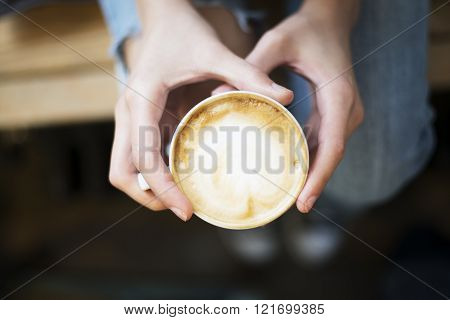 Hands holding fresh coffee