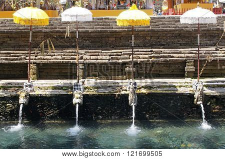 BALI, INDONESIA - DECEMBER 01, 2015: Holy springs of Pura Tirta Empul, one of the sights of Bali on December 01, 2015 in Bali, Indonesia
