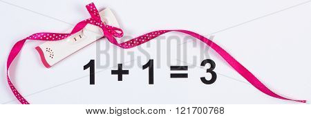 Pregnancy Test With Positive Result Wrapped Ribbon On White Background, Expecting For Baby
