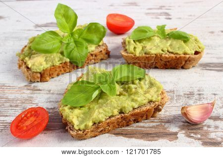 Freshly Sandwiches With Paste Of Avocado And Ingredients, Healthy Food And Nutrition