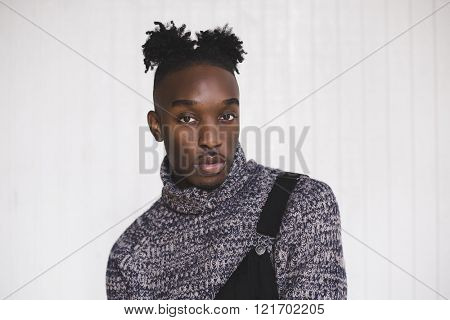 Portrait of a young afroamerican indoors wearing a jumpsuit with style