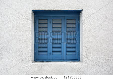 Wooden window shutters - Closed old shuttered weathered wooden window in the Limassol Cyprus