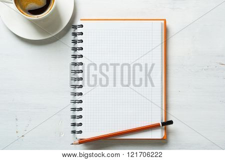 Coffee with notepad and pen
